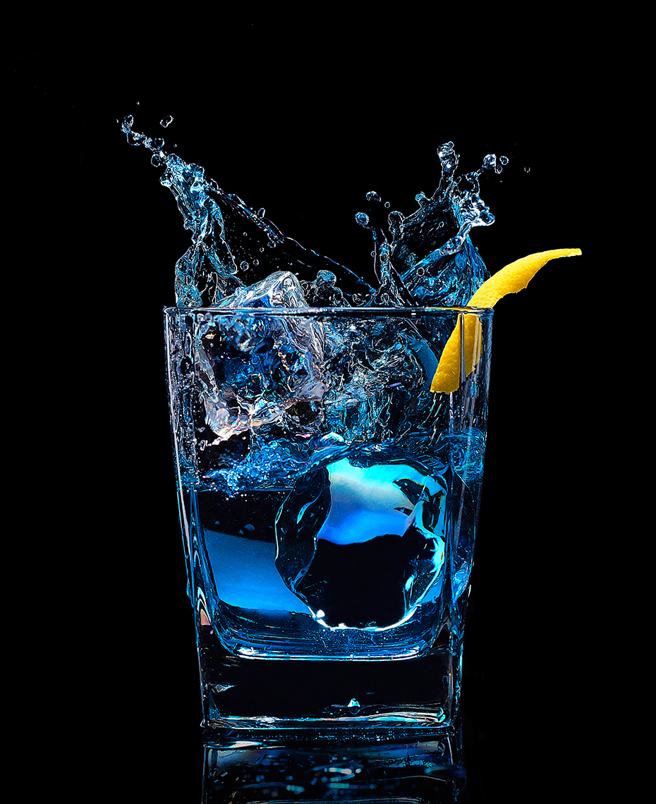 beverage photo of blue liquor splash by brian kaldorf