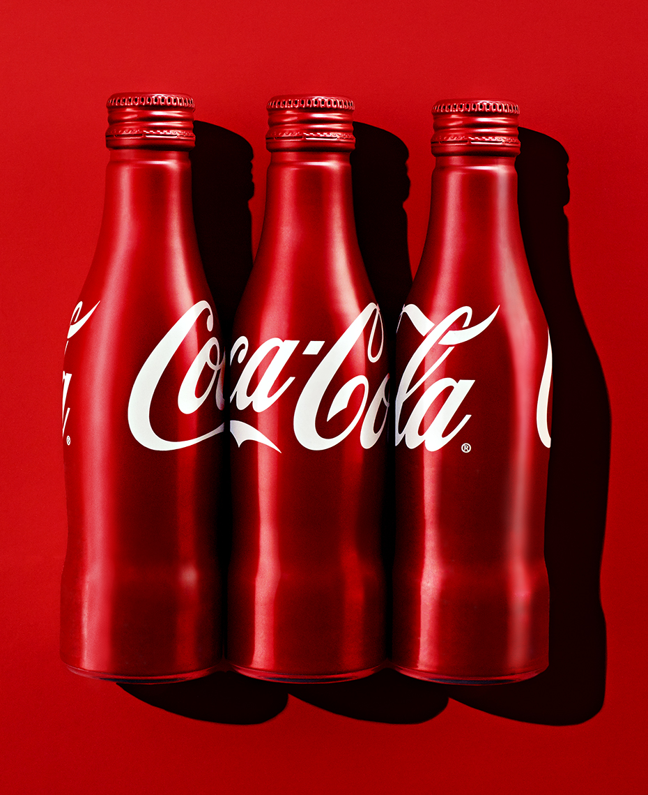 beverage photo of coca cola bottles by Brian Kaldorf