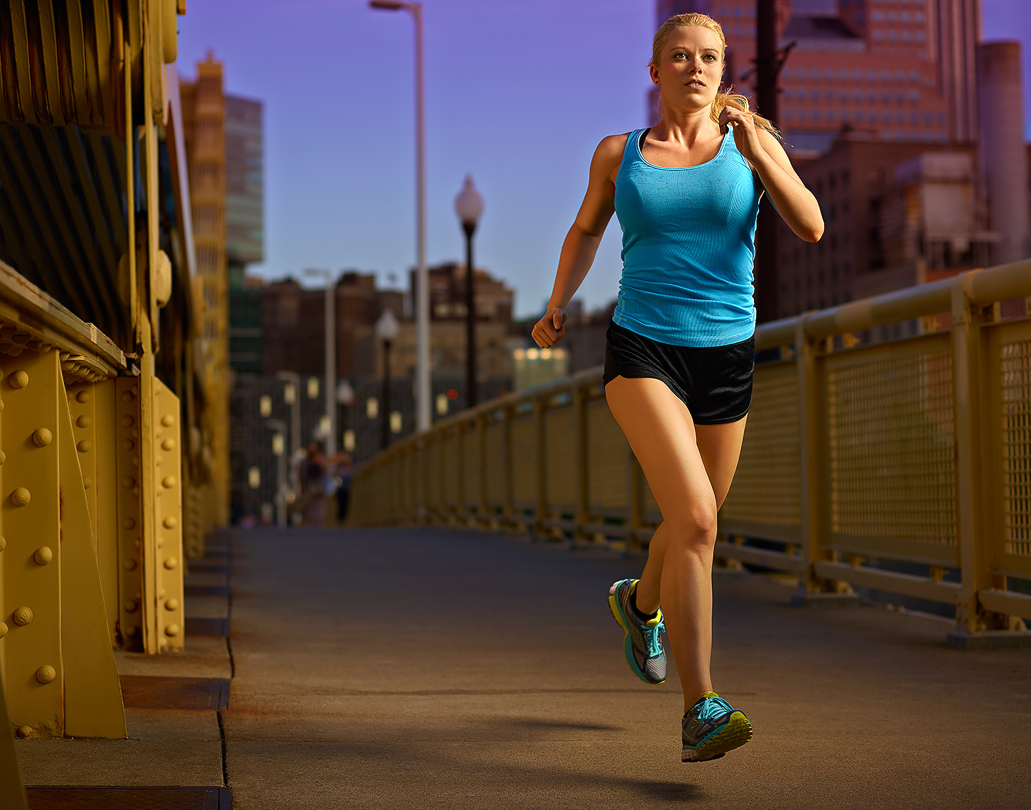 action photo of runner on roberto clemente bridge by brian kaldorf
